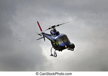 in control - chopper in flight, Westland, New Zealand
