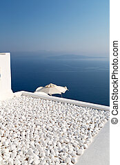 in cyclades town white and the sky