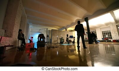 In dark studio scenery and equipment for shootings are put