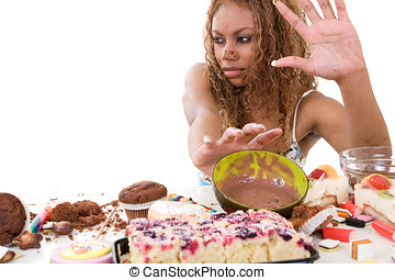 in denial - Pretty black girl pushing away the food she has...
