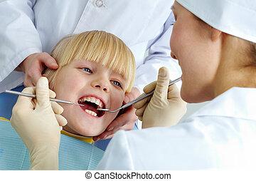 In dental clinic - Image of little girl having her teeth...