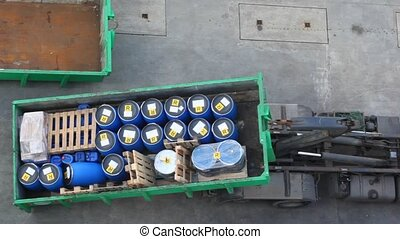 in dock truck loads on itself container with barrels