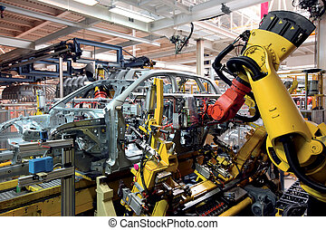 in factory - robots welding in an automobile factory