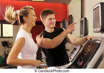In fitness centre - The attractive woman and man training in...