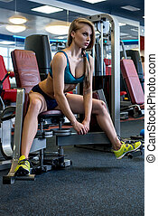 In fitness room. Girl during training on simulator