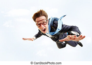 In flight - Conceptual image of young businessman flying...
