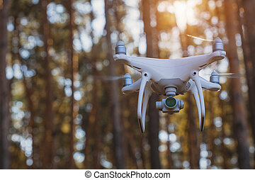 in-flight drone quadrocopter with digital camera
