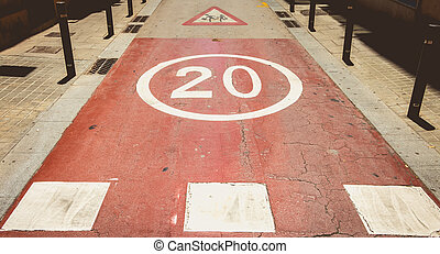 in front of a pedestrian crossing, white paint forbidden to exceed the speed of 20