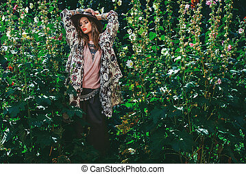 in front of tall plants - Fashion shot. Beautiful sexy woman...