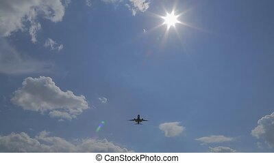 in front of the sun the aircraft comes to land.