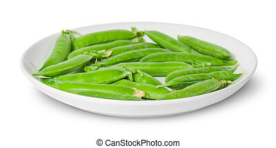 In front several pods of peas on a white plate