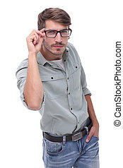in full growth. a young man looking through his glasses