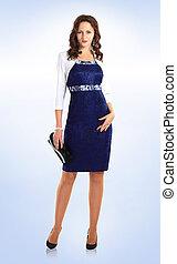 in full growth. beautiful woman model in business dress