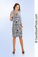 in full growth. beautiful woman model in elegant business dress.