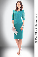 charming woman model in blue knitted suit
