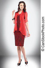 charming young woman in red dress for business meetings