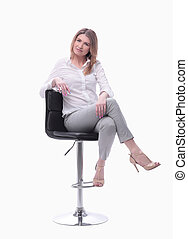 confident modern woman sitting on a chair . isolated on white background