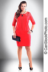 in full growth. confident woman in a stylish red dress