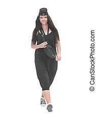 in full growth. elegant woman in black outfit walking forward.