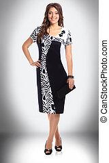 full growth. elegant woman model in stylish dress
