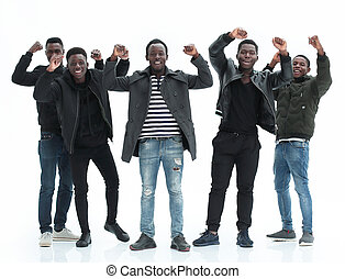group of happy guys standing with hands up . isolated on white