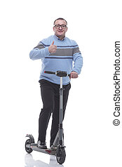 in full growth. modern mature man with electric scooter