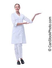 smiling doctor woman pointing on copy space. isolated on white