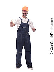 smiling man in overalls showing thumbs up . isolated on white