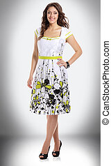 smiling woman in summer dress with floral pattern