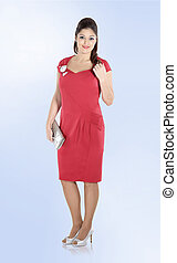 stylish woman model in red dress . isolated on white