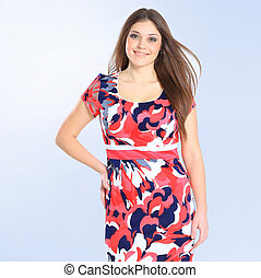 in full growth. stylish young woman in bright summer dress