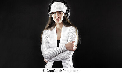in full growth. stylish young woman with headphones