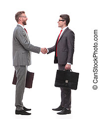 in full growth. two business men shaking hands