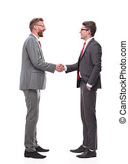 in full growth. two business men shaking hands.