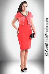 in full growth. woman model in red dress with stylish accessories
