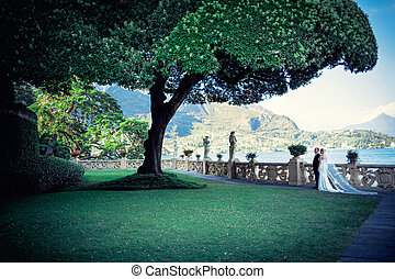 In garden - Young newly married couple in garden