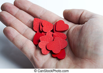 In hand lot of red hearts.