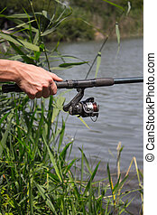 in hands of fishing rod Reel