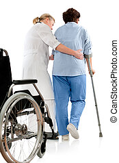 in hospital - nurse helps a senior woman on crutches
