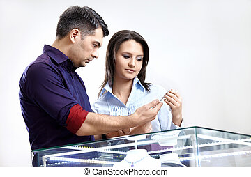 The buyer and the seller choose a jewel