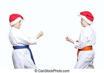 In karategi sportsmens are standing