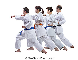 In karategi the sportsmen are hitting a punch on a white background