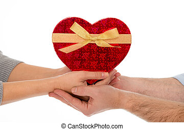 in love couple holding a love heart on white background