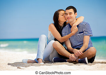 in love couple on the sea beach in summertime.