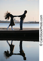 In love - The in love pair walks on the bridge