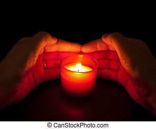 In loving memory - votive candle with hands, natural candlelight