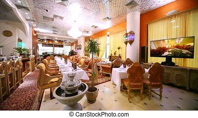 In magnificent lounge of restaurant there is TV and fountain