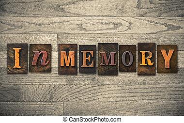 """The words """"IN MEMORY"""" written in vintage wooden letterpress type."""