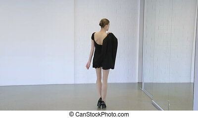 In model school female is walking up and down with jacket.