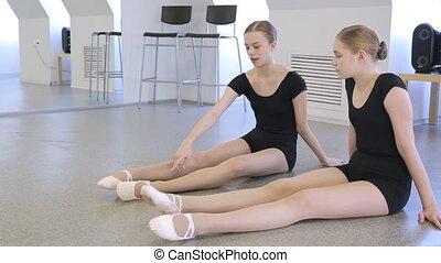 In model school females are preparing for dance class.